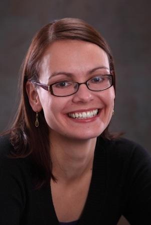 Portrait photo of Anna Staniszewski smiling