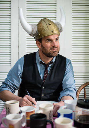 Grant Faulkner wearing a horned helmet writing